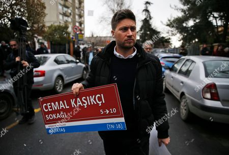 Andrew Gardner of Amnesty International holds an unofficial street sign reading in Turkish: 'Jamal Khashoggi Street', during a protest near the Saudi consulate in Istanbul, marking the 100th day since Saudi journalist Jamal Khashoggi was killed in the kingdom's consulate on Oct. 2. The activists reiterate their call on the international community for an investigation. Turkey authorities say Khashoggi was killed by a 15-member Saudi hit-squad and that his body was dismembered before being removed from the consulate