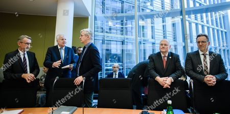 President of the Federal Office for Security in Information Technology (BSI) in Germany Arne Schoenbohm (4-L) and President of Federal Criminal Police Office (Bundeskriminalamt, BKA) Holger Muench (R) wait next to German Minister of Interior, Construction and Homeland Horst Seehofer (2-L) talking to Member of Parliament Mathias Middelberg (3-L) and Member of Parliament Armin Schuster (L) prior to the beginning of a session of the 33rd Committee on internal affairs at the German Bundestag in Berlin, Germany, 10 January 2019. Seehofer attends the committee for a briefing on the unauthorised publication of personal data of politicians, journalists and public figures, by a hacker via Twitter.