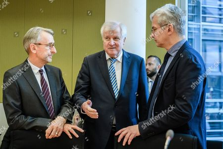 German Minister of Interior, Construction and Homeland Horst Seehofer (C) talks to to Member of Parliament Mathias Middelberg (R) and Member of Parliament Armin Schuster (L) as he arrives for a session of the 33rd Committee on internal affairs at the German Bundestag in Berlin, Germany, 10 January 2019. Seehofer attends the committee for a briefing on the unauthorised publication of personal data of politicians, journalists and public figures, by a hacker via Twitter.