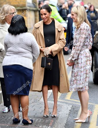 Meghan Duchess of Sussex, Lady Juliet Hughes-Hallett, chair of Smart Works, and Kate Stephens, Smart Works' CEO