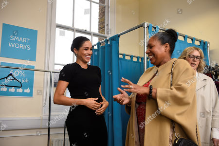 Meghan Duchess of Sussex, chats with Patsy Wardally, during her visit at Smart Works charity
