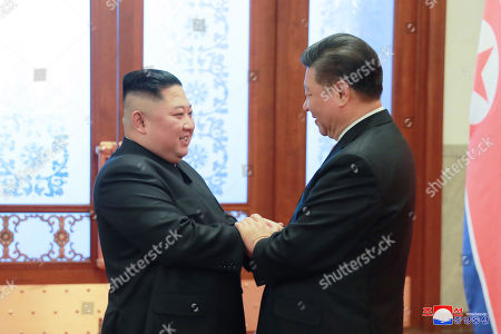 A photo released by the official North Korean Central News Agency (KCNA) shows North Korean leader Kim Jong-un (L) shaking hands with Chinese President Xi Jinping (R) during his visit in Beijing, China, 10 January 2019. North Korean leader Kim Jong-un is in China at the invitation of Chinese President Xi Jinping from 07 to 10 January with his wife Ri Sol-ju.