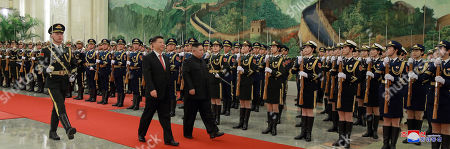 A photo released by the official North Korean Central News Agency (KCNA) shows North Korean leader Kim Jong-un (C) inspecting the guards of honor with Chinese President Xi Jinping (C-L) during his visit in Beijing, China, 10 January 2019. North Korean leader Kim Jong-un is in China at the invitation of Chinese President Xi Jinping from 07 to 10 January with his wife Ri Sol-ju.