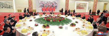 A photo released by the official North Korean Central News Agency (KCNA) shows North Korean leader Kim Jong-un (C) attends a  meeting with his wife Ri Sol-ju (C-L) and Chinese President Xi Jinping (C-R) during his visit in Beijing, China, 10 January 2019. North Korean leader Kim Jong-un is in China at the invitation of Chinese President Xi Jinping from 07 to 10 January with his wife Ri Sol-ju.