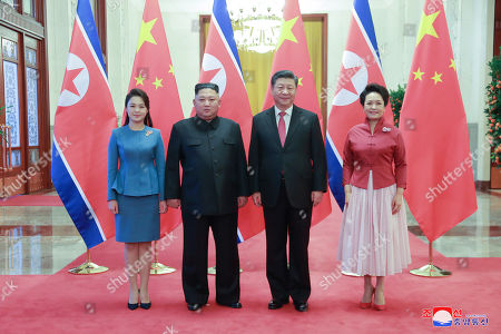 A photo released by the official North Korean Central News Agency (KCNA) shows North Korean leader Kim Jong-un (C-L), his wife Ri Sol-ju (L), Chinese President Xi Jinping (C-R), and his wife Peng Liyuan (R) posing for a photo in Beijing, China, 10 January 2019. North Korean leader Kim Jong-un is in China at the invitation of Chinese President Xi Jinping from 07 to 10 January with his wife Ri Sol-ju.