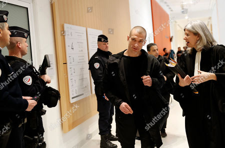 Russian performance artist Pyotr Pavlensky arrives with his lawyer Dominique Beyreuther Minkov at the Paris courthouse, . Pavlensky goes on trial after he set fire to the facade of France's central bank in Paris on Oct.16, 2017