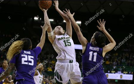 Lauren Cox, Jasauen Beard, Peyton Williams. Baylor forward Lauren Cox, center, shoots over Kansas State forward Jasauen Beard, left, and Kansas State forward Peyton Williams, right, in the first half of an NCAA college basketball game, in Waco, Texas