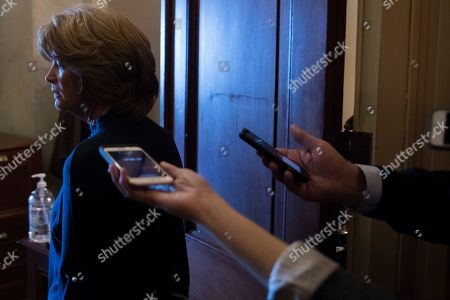 Sen. Lisa Murkowski, R-Alaska, speaks to reporters as she walks into the office of Senate Majority Leader Mitch McConnell of Ky. for a meeting with Senate Republicans on Capitol Hill in Washington