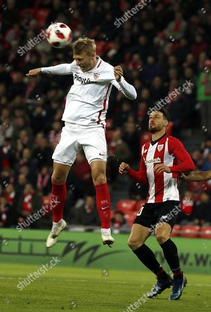 Sevilla FC's Simon Kjaer (L) in action against Athletic Bilbao's Aritz Aduriz (R) during a Spanish King's Cup round of 16 soccer match between Athletic Bilbao vs Sevilla FC at San Mames stadium in Bilbao, northern Spain, 10 January 2019.