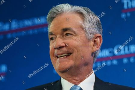 Federal Reserve Board Chair Jerome Powell looks tot he audience as he talks with Carlyle Group co-CEO David Rubenstein during the Economic Club of Washington luncheon, in Washington