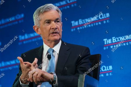 Federal Reserve Board Chair Jerome Powell talks with Carlyle Group co-CEO David Rubenstein during the Economic Club of Washington luncheon, in Washington