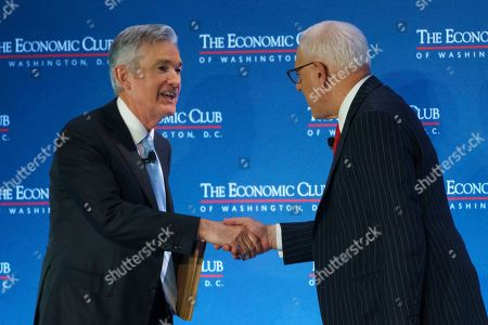 David Rubenstein, Jerome Powell. Federal Reserve Board Chair Jerome Powell shakes hands with Carlyle Group co-CEO David Rubenstein after speaking during the Economic Club of Washington luncheon, in Washington