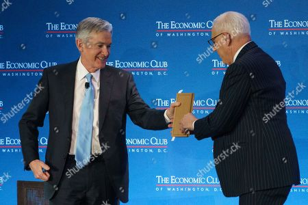 David Rubenstein, Jerome Powell. Federal Reserve Board Chair Jerome Powell is presented with a gift from Carlyle Group co-CEO David Rubenstein after speaking during the Economic Club of Washington luncheon, in Washington
