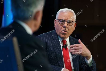 Carlyle Group co-CEO David Rubenstein, right, talks with Federal Reserve Board Chair Jerome Powell during the Economic Club of Washington luncheon, in Washington
