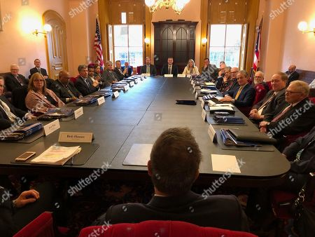 Outgoing Ohio Gov. John Kasich meets with members of his Cabinet for the final time, at the Ohio Statehouse in Columbus, Ohio