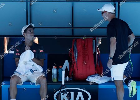 Japan's Kei Nishikori talks with his coach Michael Chang, right, during a break in his practice match against Belgium's David Goffin at the Australian Open tennis championships in Melbourne, Australia