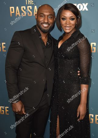 Stock Photo of Adrian Holmes and Caroline Chikezie