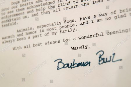 This, photo shows a detail of the letter former first lady Barbara Bush wrote to the American Kennel Club Museum of the Dog on the occasion of it's opening in 1990, on display in New York. The collection features paintings of White House dogs: U.S. President George W. Bush's Scottish terriers, Barney and Miss Beazley, and one of President George H.W. Bush's English springer spaniels, Millie