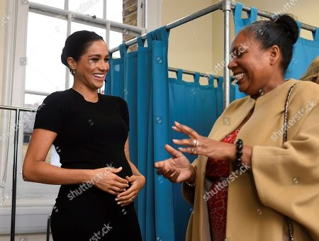 Meghan Duchess of Sussex, speaks to Patsy Wardally, during her visit to Smart Works, in London, on the day that she has become their patron, in West London.