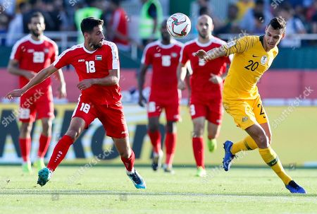 Australia's defender Trent Sainsbury, right, and Palestine's defender Day Dabbagh go for the balld uring the AFC Asian Cup group B soccer match between Australia and Palestine at Al Maktoum Stadium in Dubai, United Arab Emirates