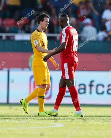 Stock Image of Australia's Robbie Kruse and Palestine's Khaled Salem, right, greet each other as they leave the pitch at the end of the AFC Asian Cup group B soccer match between Australia and Palestine at Al Maktoum Stadium in Dubai, United Arab Emirates, . Australia won 3-0