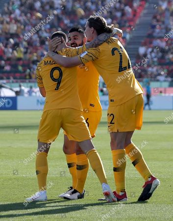 Australia's forward Jamie Maclaren, left, celebrates with teammates after scoring his side's opening goal during the AFC Asian Cup group B soccer match between Australia and Palestine at Al Maktoum Stadium in Dubai, United Arab Emirates