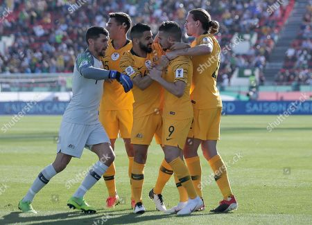 Australia's forward Jamie Maclaren, 2nd right, celebrates with teammates after scoring his side's opening goal during the AFC Asian Cup group B soccer match between Australia and Palestine at Al Maktoum Stadium in Dubai, United Arab Emirates