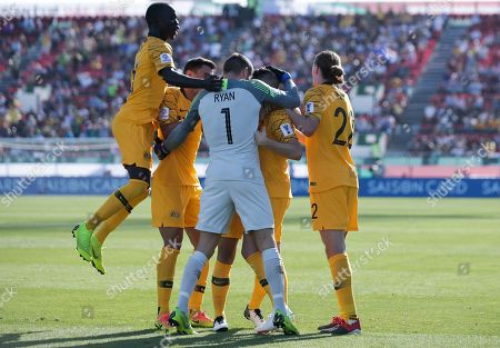 Australia's forward Jamie Maclaren, l2nd right, celebrates with teammates after scoring his side's opening goal during the AFC Asian Cup group B soccer match between Australia and Palestine at Al Maktoum Stadium in Dubai, United Arab Emirates