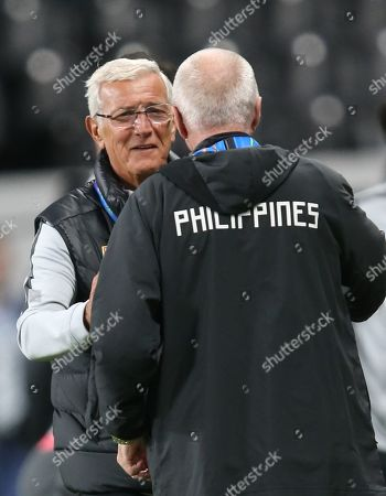 Marcello Lippi (L) head coach of China hugs with Sven-Goran Eriksson head coach of Philippines after the 2019 AFC Asian Cup group C preliminary round match between Philippines and China in Abu Dhabi, United Arab Emirates, 11 January 2019.
