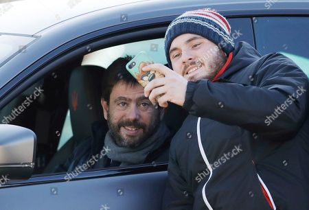 A supporter takes a picture with Juventus' president Andrea Agnelli as he arrives for a training session at the Continassa Juventus center, in Turin, Italy, . Las Vegas police say investigators are asking Italian authorities to obtain a DNA sample from Cristiano Ronaldo in an ongoing rape investigation