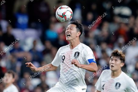 South Korea's defender Kim Young-Gwon heads the ball during the AFC Asian Cup group C soccer match between Kyrgyzstan and South Korea at Hazza Bin Zayed Stadium in Al Ain, United Arab Emirates