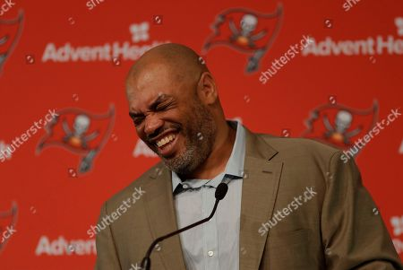 New Tampa Bay Buccaneers assistant head coach and run game coordinator Harold Goodwin laughs during a news conference, in Tampa, Fla