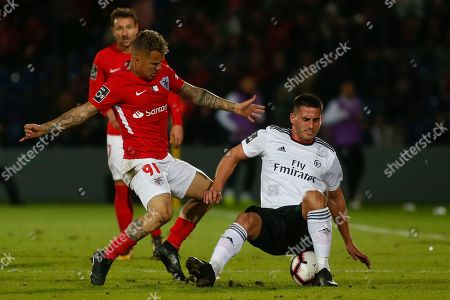 Santa Clara's player Patrick Vieira (L) in action against Benfica's player Grabriel (R) during their Portuguese First League soccer match held at Sao Roque stadium in Ponta Delgada, Azores island, Portugal, 11 January 2019.