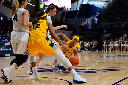 Marquette's Danielle King (1) loses her footing and the ball against Villanova during the third quarter of an NCAA college basketball game, in Bryn Mawr, Pa. Marquette won 91-55