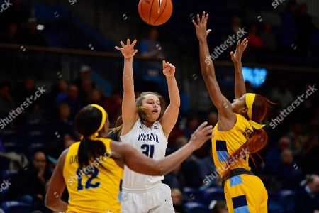 Villanova's Adrianna Hahn (31) passes the ball between Marquette's Erika Davenport (12) and Danielle King during the first quarter of an NCAA college basketball game, in Bryn Mawr, Pa. Marquette won 91-55