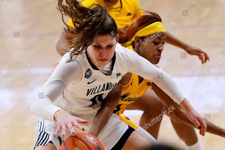Villanova's Cameron Onken, left, is pressured by Marquette's Danielle King during the second quarter of an NCAA college basketball game, in Bryn Mawr, Pa. Marquette won 91-55