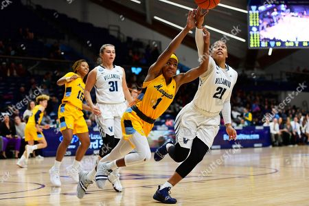 Marquette's Danielle King (1) and Villanova's Jannah Tucker (21) vie for the ball during the second quarter of an NCAA college basketball game, in Bryn Mawr, Pa. Marquette won 91-55
