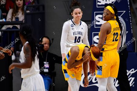 Marquette's Danielle King (1) reacts to getting poked in the face against Villanova during the fourth quarter of an NCAA college basketball game, in Bryn Mawr, Pa. Marquette won 91-55