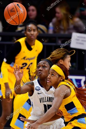 Marquette's Danielle King (1) and Villanova's Raven James (10) eye the ball during the fourth quarter of an NCAA college basketball game, in Bryn Mawr, Pa. Marquette won 91-55