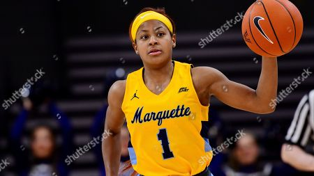 Danielle King dribbles the ball during a Marquette at Villanova NCAA college basketball game, in Bryn Mawr, Pa