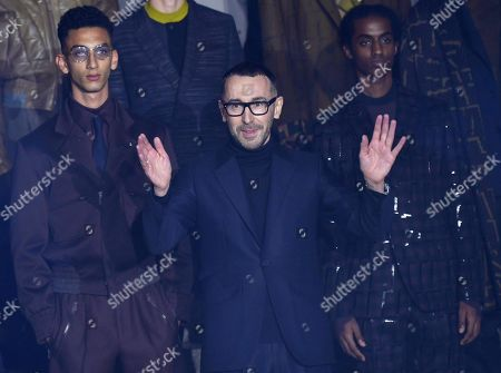 Italian designer Stefano Pilati (C) waves to the audience at the end of the presentation of his Fall/Winter 2019/20 collection for Ermenegildo Zegna during the Milan Men's Fashion Week, in Milan, Italy, 11 January 2019. Fall/Winter 2019/20 collections are presented at the Milano Moda Uomo from 11 to 14 January.