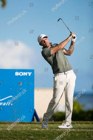 Honolulu, Hawaii: Russell Henley hits his tee shot on the 17th hole during the second round of the Sony Open at Waialae Country Club in Honolulu, Hawaii