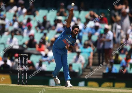 India's Bhuvneshwar Kumar bowls a abll that will take the wicket of Australia's Aaron Finch during their one day international cricket match in Sydney
