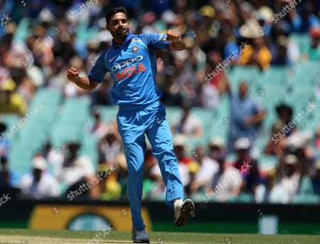 India's Bhuvneshwar Kumar celebrates after bowling out Australia's Aaron Finch during their one day international cricket match in Sydney