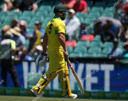 Australia's Aaron Finch walks off after he was bowled by India during their one day international cricket match in Sydney