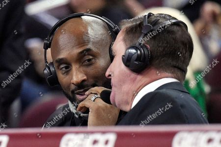 Kobe Bryant, Jim Watson. Former Los Angeles Laker Kobe Bryant, left, talks with sportscaster Jim Watson during the second half of an NCAA college basketball game between Oregon and Southern California, in Los Angeles. Oregon won 93-53