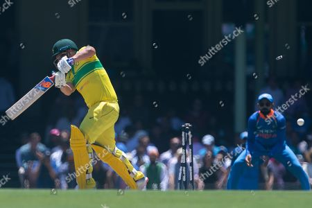 Aaron Finch (L) of Australia is out bowled by India's Bhuvneshwar Kumwr during the first One Day International match between Australia and India at the SCG in Sydney, Australia, 12 January 2019.