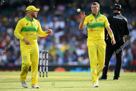 Aaron Finch (L) and Peter Siddle (2-R) of Australia speak during the first One Day International match between Australia and India India at the Sydney Cricket Ground (SCG) in Sydney, Australia, 12 January 2019.