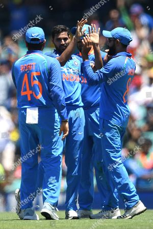 Bhuvneshwar Kumar of India (2-L) celebrates with teammates after taking the wicket of Aaron Finch of Australia during the first One Day International match between Australia and India India at the Sydney Cricket Ground (SCG) in Sydney, Australia, 12 January 2019.