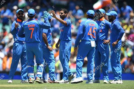 Bhuvneshwar Kumar of India (C) celebrates with teammates after taking the wicket of Aaron Finch of Australia during the first One Day International match between Australia and India India at the Sydney Cricket Ground (SCG) in Sydney, Australia, 12 January 2019.